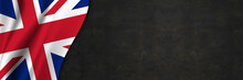 United Kingdom Flag On Concrete Wall. Banner With Fabric Texture Of The Flag Of United Kingdom