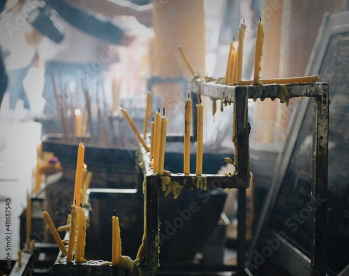 Fototapeta Close-up Of Candles In Temple obraz