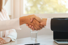 Close Up Hand Of Home, Apartment Agent Or Realtor Handshake With New Landlord, Tenant Or Rental. After The Banker Has Approved And Signed The Purchase Contract Agreement Successfully.Property Concept.