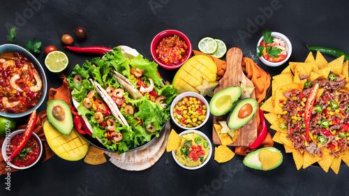 Fotografie, Obraz Mexican food, nachos, guacamole, meat tacos on dark background