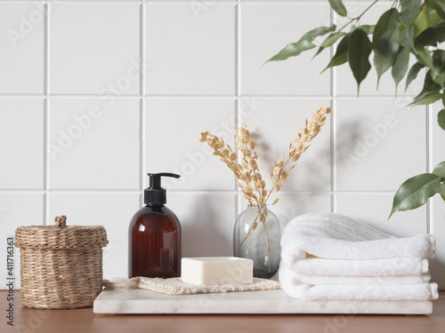 Obraz White bath background front view with cosmetic bottle and bath accessories - fototapety do salonu