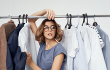 Woman Near Clothes On A Wardrobe Hanger Fashion Style Model