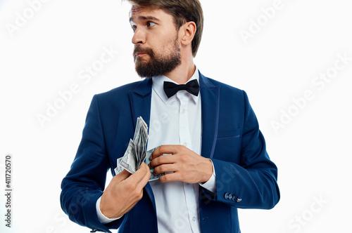Fotografia rich gentleman in blue jacket bow tie shirt money pack currency