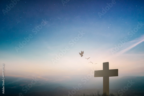 Fotografie, Obraz Silhouette jesus christ crucifix on cross on calvary sunset background concept for good friday he is risen in easter day, good friday worship in God, Christian praying in holy spirit religious