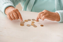 Senior Woman Counting Coins On Table. Concept Of Pension