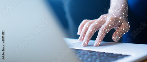 Fototapeta close up on robot hand working on laptop to checking correct data by using RPA function software program to help proof and detect and synchronize to system for future technology of business concept obraz