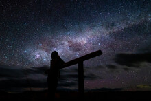 Silhouette Of A Man Stargazing In Tekapo, New Zealand