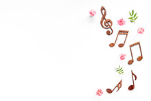 Flat Lay Of Musical Notes With Flowers. Love Songs Concept