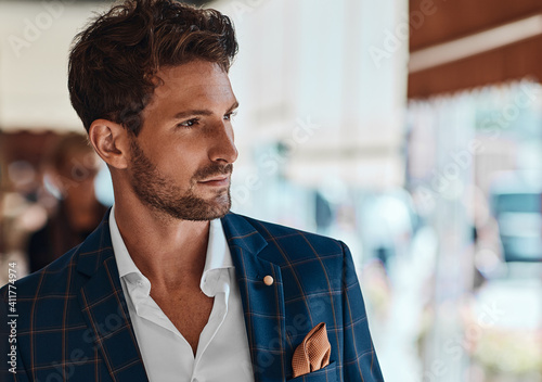 Obraz Portrait of handsome man in checked suit - fototapety do salonu