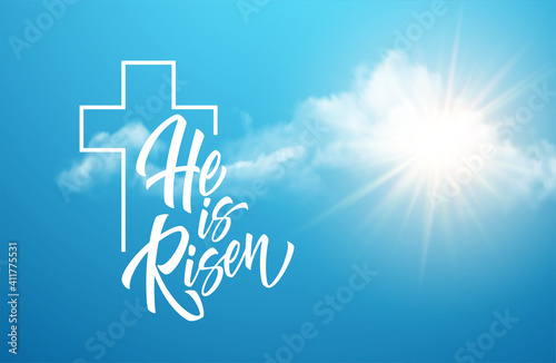 Fotografia He was resurrected lettering against a background of clouds and sun
