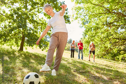 Canvas Active and vital senior woman playing soccer
