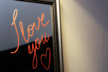 """""""I Love You"""" Written With Lipstick On The Mirror"""