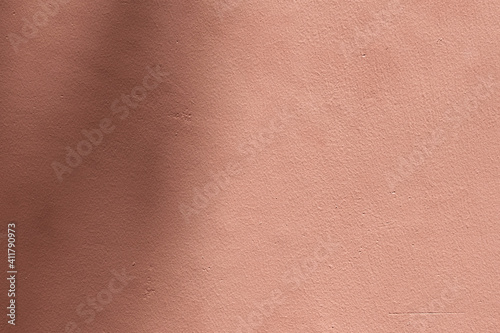 Shadow pink background with cement texture