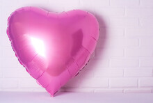 Pink Foil Balloon As A Heart On A White Background. Balloons, Romance Concept, Valentine's Day. Balloons Heart