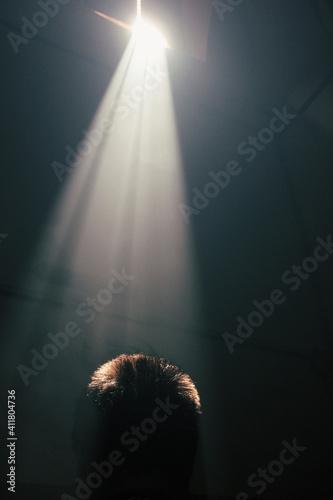 Tela divine illumination. light falls on a man's head