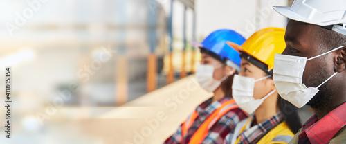 Fototapeta Portrait of industrial workers wearing surgical masks.