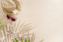 Straw Hat With Frangipani Flowers, Sea Shells And Sunglasses On White  Sand< With Palm Tree Shadow.