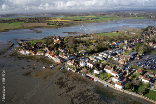 Tableau sur Toile Bosham Village and estuary aerial view with dramatic cumulus cloud on the horizon