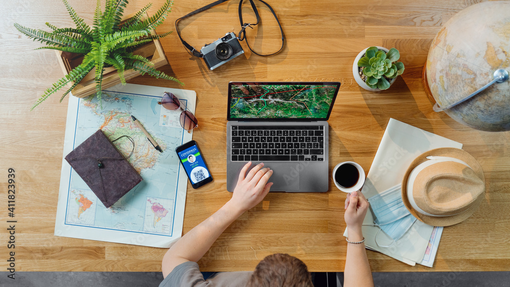 Fototapeta Top view of young man with laptop planning vacation trip holiday, desktop travel covid-19 concept