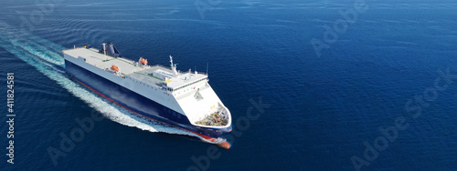 Fototapeta Aerial drone ultra wide photo of large RoRo (Roll on-off) vessel cruising the At