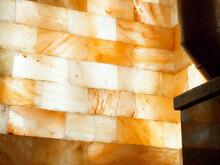 Sauna Interior With Lighting And A Stack Of Himalayan Rock Salt