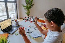 Boy Watching Online Lesson Chemistry Science Holding Molecular Model