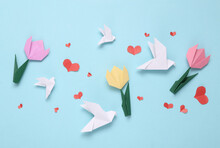 Spring Festive Composition Of Origami Tulip Flowers, Doves, Hearts On A Blue Background
