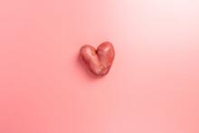 Unusually Heart Shape Potato On Pink Background, Food Shape