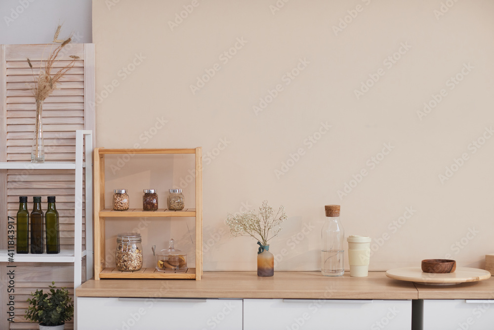 Fototapeta Graphic background image of minimal kitchen interior with pastel colored wall and floral accents, copy space