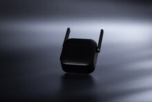 Amplifier Of Wifi Cover. Network Amplifier On Black.