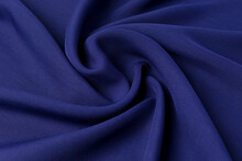The Natural Cotton Fabric Of Blue Is Stacked With Waves. The Concept Of Design In The Interior, The Selection Of Drapery And Textiles