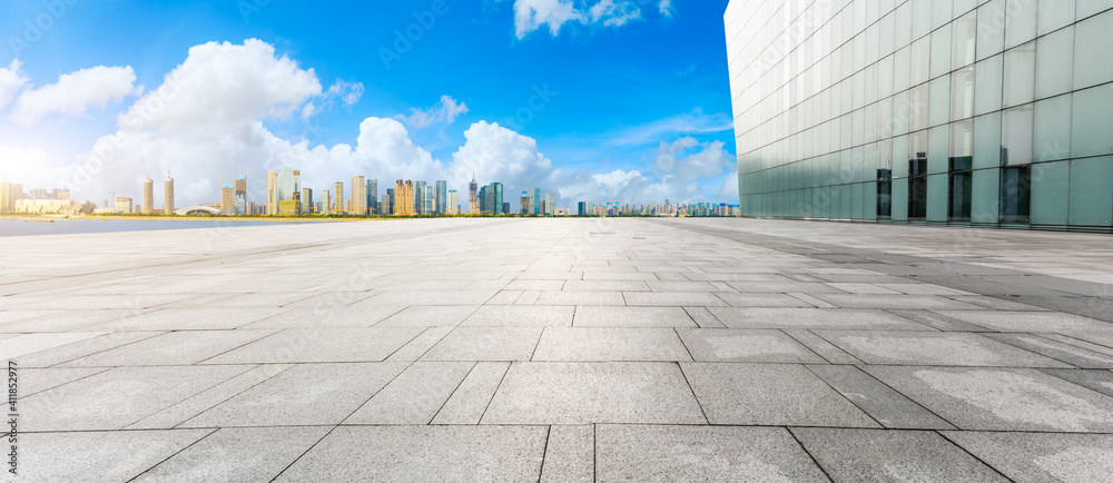 Fototapeta Empty square floor and modern city skyline with buildings in Hangzhou.
