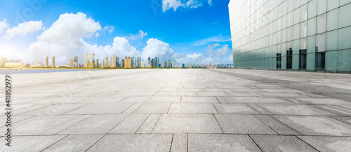 Fototapeta Empty square floor and modern city skyline with buildings in Hangzhou. obraz