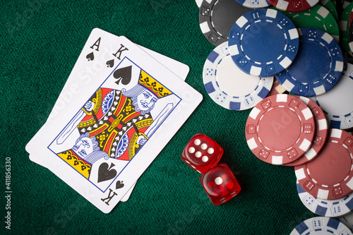 Stack of chips and two aces on the table on the green baize - poker game concept © Esin Deniz