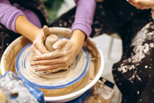 Creative Process Of Creating Pottery By Mother And Daughters. Female Hands In A Pottery Workshop.