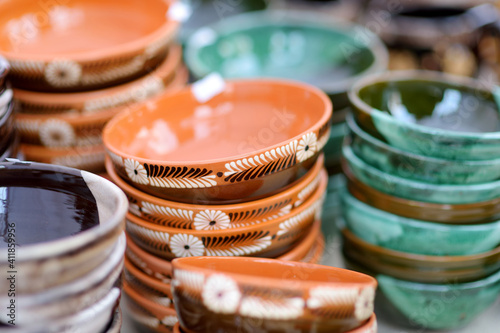 Fototapeta Ceramic dishes, tableware and jugs sold on Easter market in Vilnius. Lithuanian capital's traditional crafts fair is held every March on Old Town streets. obraz