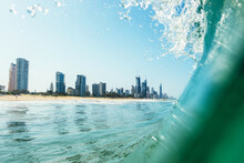 View Of The Gold Coast Skyline From Inside A Wave On The Ocean