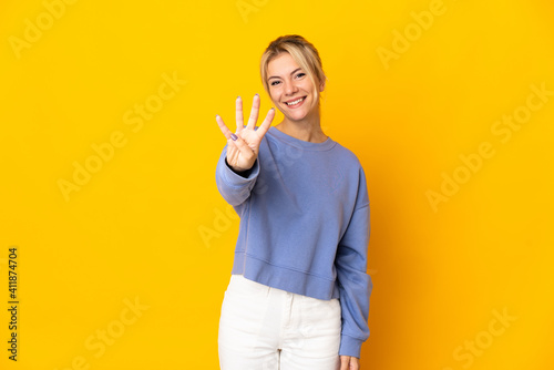 Canvas Print Young Russian woman isolated on yellow background happy and counting four with f