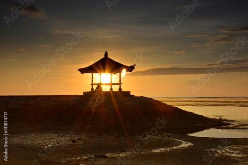 Fotografie, Obraz Gazebo On Beach Against Sky During Sunrise