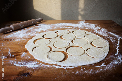 Obraz The process of making homemade dumplings with rustic cottage cheese on hard wheat dough, prepared by hand, is a great lunch dish - fototapety do salonu