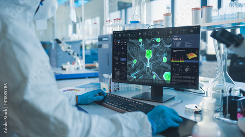 Fotomural Advanced Laboratory: Medical Scientist Working on Personal Computer Developing Vaccine, Drugs and Antibiotics