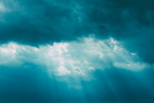 Sunrays Through Blue Rainy Dramatic Sky. Natural Abstract Background
