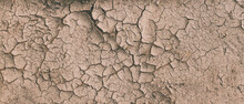 Background Of Brown Dry Cracked Soil Dirt Or Earth During Drought. Dry Cracked Earth Depicting Severe Drought Conditions. Panorama
