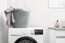 Laundry Basket On Automatic Washing Machine In Bathroom