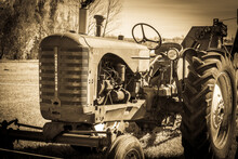 Old Rusty Tractor In Sepia