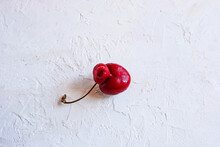 Trendy Ugly Organic Fruits - Berrie Of Sweet Cherry On The Table With Copy Space For Text. Horizontal Orientation. Buying Imperfect Products Is A Way To Deal With Food Waste