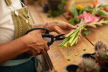 Female Florist Trimming Flower Stems With Shears
