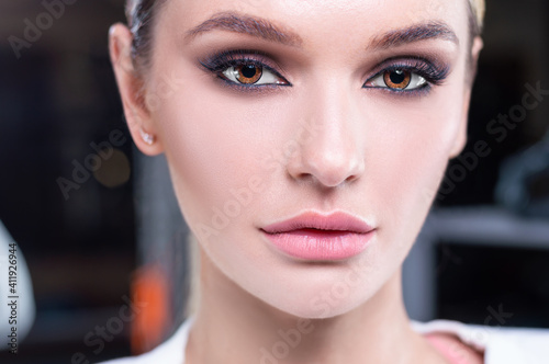 Obraz Close-up portrait of a girl. The concept of the beauty industry, cosmetology. - fototapety do salonu