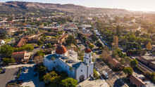 Daytime Aerial View Of The Spanish Colonial Era Mission And Surrounding City Of Downtown San Juan Capistrano, California, USA.