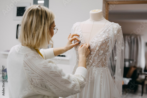 Close-up of work process of a fashion designer at her studio Fototapet
